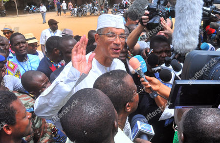 """Lionel Zinsou On, Presidential candidate, Benin prime minister Lionel Zinsou, center, speaks to media after casting his ballot during the election, in Cotonou, Benin. Early results from Benin's presidential vote show there will be a runoff election between the ruling party's chosen candidate and a cotton magnate. The West African nation's election commission released """"key trends"""" - or unofficial results - Tuesday, March 8, 2016, that gave Prime Minister Lionel Zinsou 28 percent of Sunday's vote, short of the majority required for a first-round win. Patrice Talon, known locally as """"the king of cotton,"""" came in second with 24 percent"""