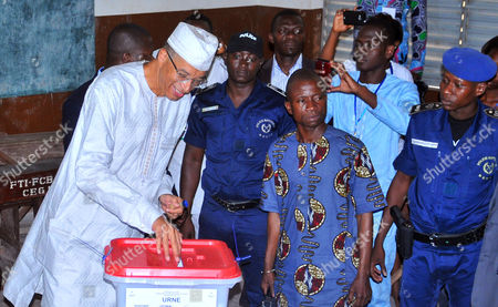 Lionel Zinsou Presidential candidate, Benin prime minister Lionel Zinsou, left, casts his ballot during the election in Cotonou, Benin, . Benin citizens voted Sunday in an election to choose a successor to the West African nation's president, who is stepping down after two terms