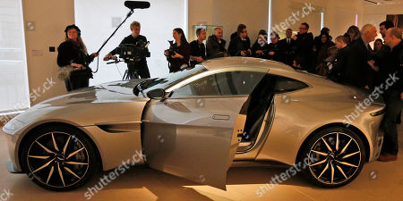 The James Bond Aston Martin of the latest Spectre movie is surrounded by people at the auction house Christie's in London, . The Aston Martin is one of the 24 items of Spectre memorabilia that come directly from the archives of EON Productions, with unique donations from Daniel Craig, Sam Mendes, Michael G. Wilson, Barbara Broccoli, Jesper Christensen and Sam Smith an it's auction on February 15, 2016. The car is expected to realise between £1,000,000 and £1,500,000 (1,45 million-2,17 million USD) and is to date the only DB10 to be released for public sale by EON Productions and Aston Martin