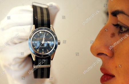 A Christie's employee shows the wristwatch made for James Bond and the latest Spectre movie at the auction house Christie's in London, . The watch is one of the 24 items of Spectre memorabilia that come directly from the archives of EON Productions, with unique donations from Daniel Craig, Sam Mendes, Michael G. Wilson, Barbara Broccoli, Jesper Christensen and Sam Smith an it's auction on February 15, 2016. The estimate of the watch is 15,000-20,000 GBP, (21,000-29,000 USD