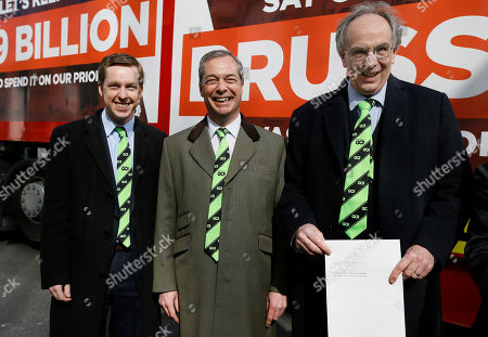 Conservative Members of Parliament, Tom Pursglove, left, and Peter Bone, right, stand with Nigel Farage, leader of Britain's UKIP party, as they hold the application letter outside the Electoral Commission, in London. With less than three months to go until a June 23 referendum, Britain's anti-EU campaigners are bitterly divided, with two rival camps battling over which will be the standard-bearer in the campaign, and over how to win the historic vote
