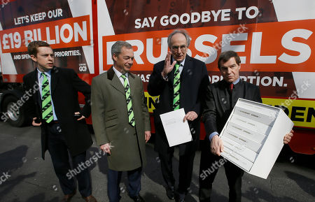 Conservative Members of Parliament, Tom Pursglove, left, and Peter Bone, second right, stand with Nigel Farage, leader of Britain's UKIP party, second left, and Nigel Griffiths, Labour Party politician, as they hold the application letter and documents outside the Electoral Commission, in London, . Grassroots Out submitted its application to the Electoral Commission for designation as the official 'Leave' campaign in the EU referendum
