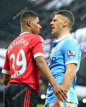 United's Marcus Rashford, left, and Manchester City's Martin Demichelis argue during the English Premier League soccer match between Manchester City and Manchester United at the Etihad stadium in Manchester