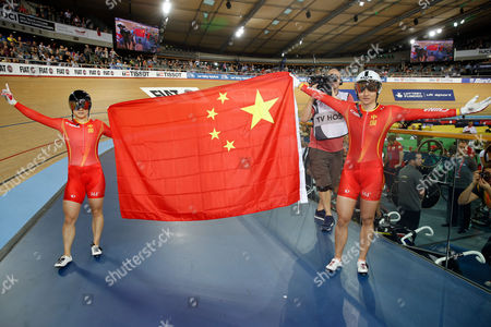 China's Tianshi Zhong, right, and Lin Junhong celebrates after winning gold and silver medals in the Women's Sprint at the World Track Cycling championships at the Lee Valley Velopark in London
