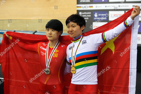 Gold medalist China's Tianshi Zhong, right, and silver medalist Lin Junhong, also from China, pose on the podium of the Women's Sprint at the World Track Cycling championships at the Lee Valley Velopark in London