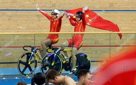China's Tianshi Zhong, left, and Lin Junhong celebrates after winning gold and silver medals in the Women's Sprint at the World Track Cycling championships at the Lee Valley Velopark in London