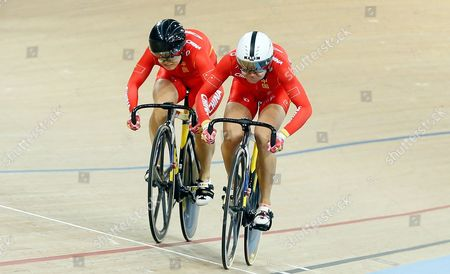 China's Tianshi Zhong, right, beats Lin Junhong, also from China, to win the gold medal in the Women's Sprint at the World Track Cycling championships at the Lee Valley Velopark in London