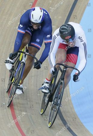 Britain's Callum Skinner, right, beats France's Gregory Bauge in the sprint 1/8 finals at the World Track Cycling championships at the Lee Valley Velopark in London