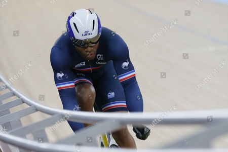 France's Gregory Bauge rides in the sprint qualifying at the World Track Cycling championships at the Lee Valley Velopark in London