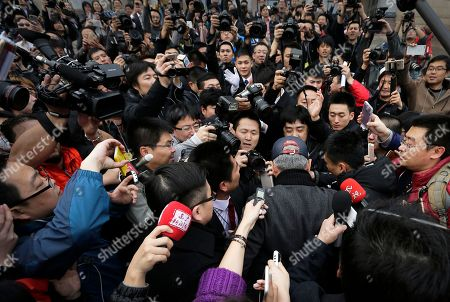 Stock Picture of Chinese celebrity and CPPCC representative Zhao Benshan, wearing a cap, is surrounded by journalists as he arrives at the Great Hall of the People to attend the opening session of the Chinese People's Political Consultative Conference (CPPCC) in Beijing, . The more than 2,000 members of China's top legislative advisory body convened their annual meeting Thursday, kicking off a political high season that will continue with the opening of the national congress on Saturday