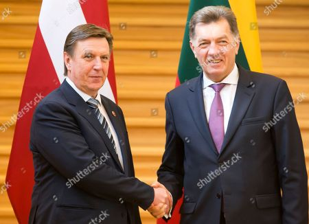 Maris Kucinskis, Algirdas Butkevicius Latvia's Prime Minister Maris Kucinskis, left, and Lithuania's Prime Minster Algirdas Butkevicius pose for photographers after their press conference at the Government Palace in Vilnius, Lithuania