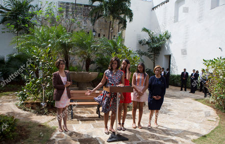 Lesbia Mendez Vargas, Michelle Obama, Malia Obama, Sasha Obama, Marian Robinson U.S. First Lady Michelle Obama speaks during a dedication ceremony for a gift of two magnolia trees and a bench, at a small park beside Ruben Martinez Villena public library in Plaza de las Armas, Old Havana, Cuba, . She is accompanied by, from right, her mother Marian Robinson, right, her daughters Sasha and Malia, and Lesbia Mendez Vargas, left, director of cultural heritage for Havana's Office of the Historian