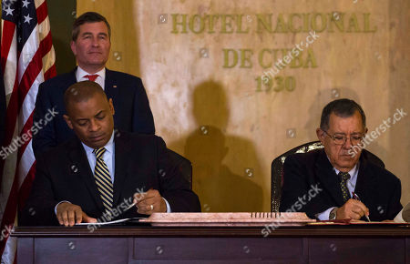 Anthony Foxx, Adel Yzquierdo Rodriguez, Charles Rivkin United States Transportation Secretary Anthony Foxx and Cuba's Minister of Transportation Adel Yzquierdo Rodriguez, right, sign the airline transportation agreement as Assistant Secretary of State for Economic and Business Affairs Charles Rivkin, top left, looks on in Havana, Cuba, . Cuba and the United States signed the agreement that will allow U.S. commercial airlines to begin operating flights to the island and vice-versa for the first time in decades