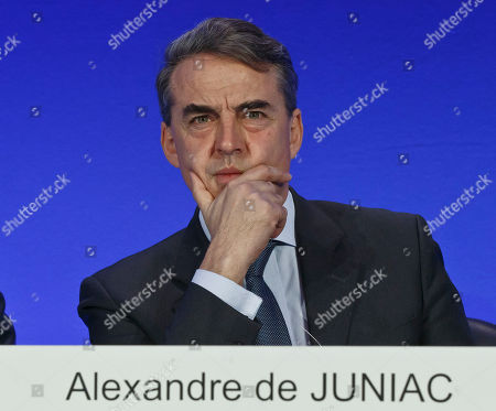 Air France-KLM's Chairman and Chief Executive Officer Alexandre de Juniac gestures as he listens to the full year 2015 results presentation in Paris, . Air France-KLM Group announced its first annual operating profit since 2010