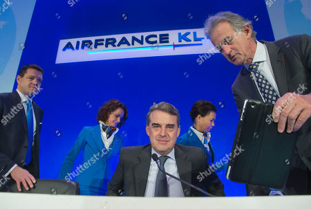 Air France-KLM's Chairman and Chief Executive Officer Alexandre de Juniac, center, KLM's President and Chief Executive Officer Pieter Elbers, right, and Air France's Chairman and Chief Executive Officer Federic Gagey arrive for the full year 2015 results presentation in Paris, . Air France-KLM Group announced its first annual operating profit since 2010