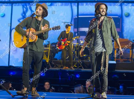 """French singers and musicians of the band """"Frero Delavega"""" Jérémy Frérot, left, and Florian Delavega, right, perform on stage during the 31st Victoires de la Musique, the annual French music awards ceremony,, in Paris, France"""