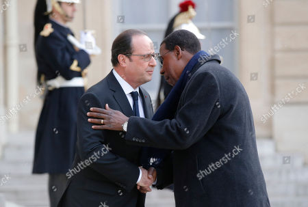 French President Francois Hollande, left, welcomes Benin's President Thomas Boni Yayi, for a meeting at the Elysee Palace in Paris, . Benin's President Thomas Boni Yayi is for a two days visit in France