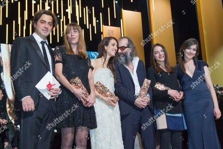 "From left, French producer Charles Gillibert, screenwriter Alice Winocour, French-Turkish director Deniz Gamze Erguven, Australian composer Warren Ellis, French film editor Mathilde Van de Moortel and Turkish actress Tugba Sunguroglu celebrate on stage with their trophy after they won the Best First Feature Film award for ""Mustang"" . at the ceremony of 41th Cesar Film Awards at Theatre du Chatelet in Paris, France"