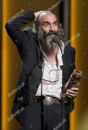 "Australian composer Warren Ellis reacts after winning the Best Original Score award for ""Mustang"" at the ceremony of the 41st Cesar Film Awards at Theatre du Chatelet in Paris, France"