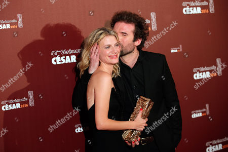 """French actress and director Melanie Laurent and French director Cyril Dion pose with the Best Documentary Film award for """"Demain,"""" (Tomorrow) during the 41st French Cesar Awards Ceremony, in Paris, . This annual ceremony is presented by the French Academy of Cinema Arts and Techniques"""