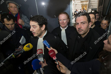 Jerome Kerviel, right, and his lawyers David Koubbi, left, and Benoît Pruvost, center, speak to the media as they leave Paris cour house in Paris, . French judicial officials are considering whether to order a new trial for former trader Jerome Kerviel, who is protesting his conviction to three years in prison for defrauding bank Societe Generale
