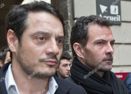Jerome Kerviel, right, and his lawyer David Koubbi, left, arrive at Paris cour house in Paris, . French judicial officials are considering whether to order a new trial for former trader Jerome Kerviel, who is protesting his conviction to three years in prison for defrauding bank Societe Generale