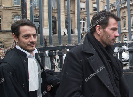 Jerome Kerviel, left, and his lawyer David Koubbi, right, leave Paris cour house in Paris, . French judicial officials are considering whether to order a new trial for former trader Jerome Kerviel, who is protesting his conviction to three years in prison for defrauding bank Societe Generale