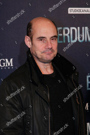 """French actor Bernard Campan poses for photographers as he arrives at the premiere of the movie """"Eperdument"""", in Paris"""