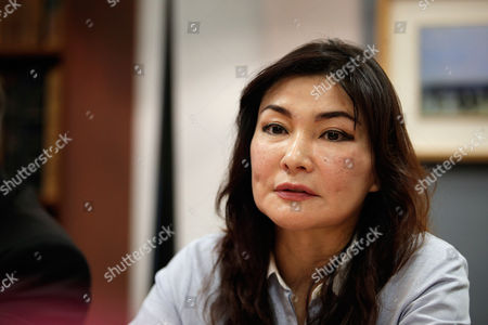 Kazakh dissident Mukhtar Ablyazov's wife Alma Shalabayeva gives a press conference, in Paris, . The wife and son of a Kazakh banker-turned-dissident are urging France's prime minister to block his pending extradition to Russia, fearing that he would face abuses. Mukhtar Ablyazov, a former Kazakh energy minister who founded an opposition party, is accused of embezzling billions from a bank he founded, BTA