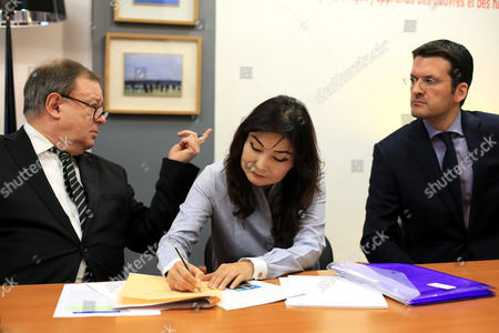 Stock Image of Kazakh dissident Mukhtar Ablyazov's wife Alma Shalabayeva, center, with Ablyazov's lawyers Jean-Pierre Mignard, left and Peter Sahlas, right, give a press conference, in Paris, . The wife and son of a Kazakh banker-turned-dissident are urging France's prime minister to block his pending extradition to Russia, fearing that he would face abuses. Mukhtar Ablyazov, a former Kazakh energy minister who founded an opposition party, is accused of embezzling billions from a bank he founded, BTA