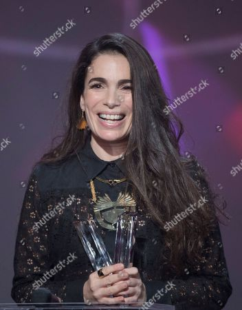Israeli-French singer-songwriter Yael Naim smiles as she received the best female artist award during the 31st Victoires de la Musique, the annual French music awards ceremony,, in Paris, France