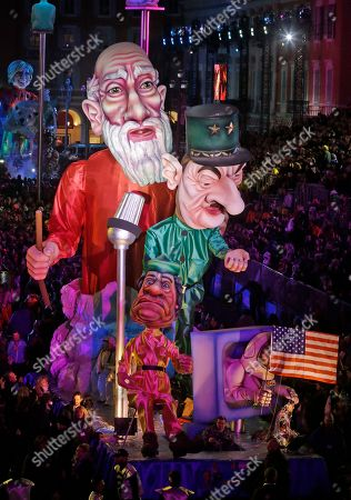 """A float showing Moise, Charles de Gaulle, and Colonel Muammar Gaddafi parades during 132th Nice carnival parade, in Nice, southeastern France. The Carnival celebrates this year the """"King of Media"""