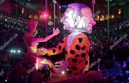 """A float showing Dominique Strauss Khan, left and Silvio Berlusconi parades during the 132nd Nice carnival parade, in Nice, southeastern France. The Carnival celebrates this year the """"King of Media"""". Dominique Strauss-Kahn is former French politician and a controversial figure of the Socialist Party who has been involved in several financial and sexual scandals and Silvio Berlusconi is an Italian media tycoon and politician who served as Prime Minister of Italy in four governments"""