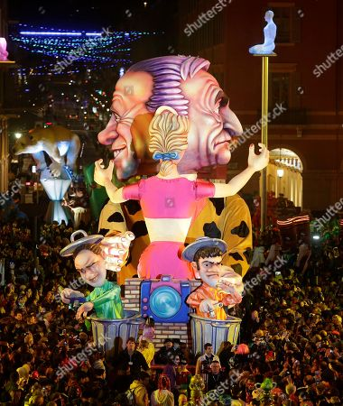 """A float showing Dominique Strauss Khan,right, and Silvio Berlusconi parades during 132th Nice carnival parade, in Nice, southeastern France. The Carnival celebrates this year the """"King of Media"""". Dominique Strauss-Kahn is former French politician and a controversial figure of the Socialist Party who has been involved in several financial and sexual scandals and Silvio Berlusconi is an Italian media tycoon and politician who served as Prime Minister of Italy in four governments"""