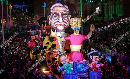 """A float showing Dominique Strauss Khan, parades during 132th Nice carnival parade, in Nice, southeastern France. The Carnival celebrates this year the """"King of Media"""". Dominique Strauss-Kahn is former French politician and a controversial figure of the Socialist Party who has been involved in several financial and sexual scandals"""