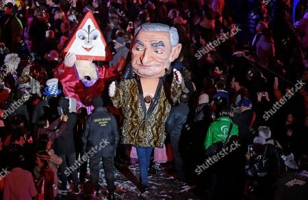 """Big head showing Dominique Strauss Kahn parades during 132th Nice carnival parade, in Nice, southeastern France. The Carnival celebrates this year the """"King of Media"""". Dominique Strauss-Kahn is former French politician and a controversial figure of the Socialist Party who has been involved in several financial and sexual scandals"""