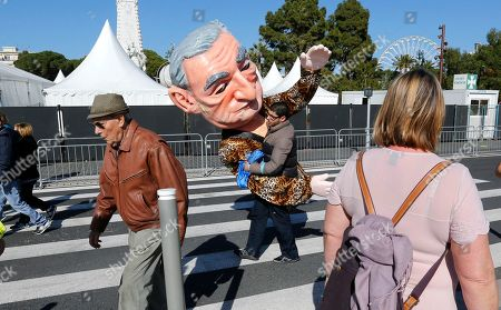 """A reveler carries big heads showing Dominique Strauss Kahn during 132th Nice carnival parade, in Nice, southeastern France. The Carnival celebrates this year the """"King of Media"""
