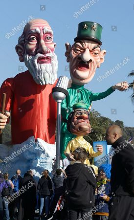 """Stock Image of A float showing Moise, Charles de Gaulle, and Colonel Muammar Gaddafi parades during during 132th Nice carnival parade, in Nice, southeastern France. The Carnival celebrates this year the """"King of Media"""