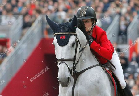 Malin Baryard-Johnsson of Sweden rides her horse H&M Cue Channa 42 during the Saut Hermes jumping at the Grand Palais in Paris
