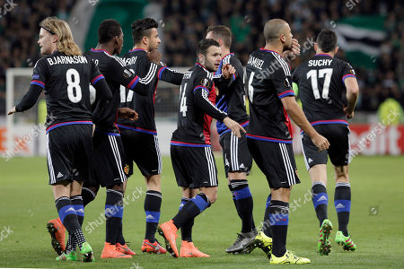 Basel' players celebrate after Walter Samuel, second right, scored a goal against Saint-Etienne during their Europa League round of 32 soccer match in Saint-Etienne, central France