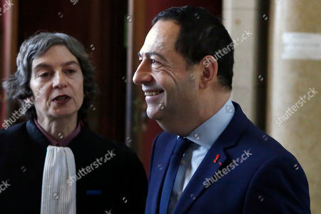 Stock Picture of Paris district Deputy mayor Jean Luc Romero, right, 56 year-old openly-gay politician and aids activist flanked with his lawyer Caroline Mecary, left, shares a smile as he arrives at the Paris court house in Paris, France, . A Twitter user appears on a French court for anti-gay death threat and public insults against a deputy mayor in a Paris district posted on the San Francisco-based social network when the councilor got married in 2013 under a new gay marriage law in a trial that raises the issue of free speech limits on online media