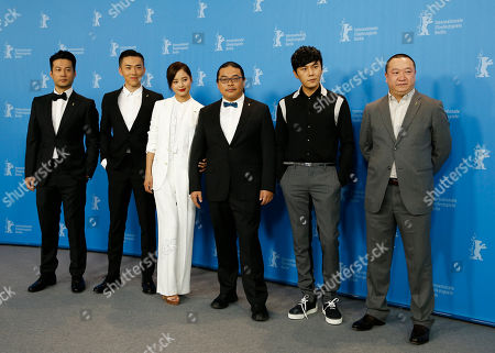 From left, actors Tan Kai, Wu Lipeng, actress Xin Zhi Lei, director Yang Chao, actor Qin Hao and producer Wang Yu pose, during the photo call for the movie ' Chang Jiang Tu', at the 2016 Berlinale Film Festival in Berlin