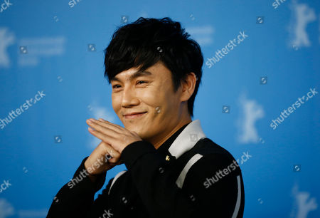 Stock Photo of Actor Qin Hao poses during the photocall for the movie ' Chang Jiang Tu', at the 2016 Berlinale Film Festival in Berlin