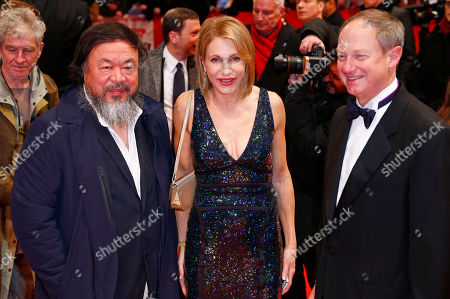 """Stock Photo of Chinese artist Ai Weiwei, left, Kimberly Marteau Emerson, wife of the American Ambassador to Germany John Emerson, right, pose for a photograph at the red carpet for """"Hail, Caesar!"""" the opening film of the 2016 Berlinale Film Festival in Berlin, Germany"""
