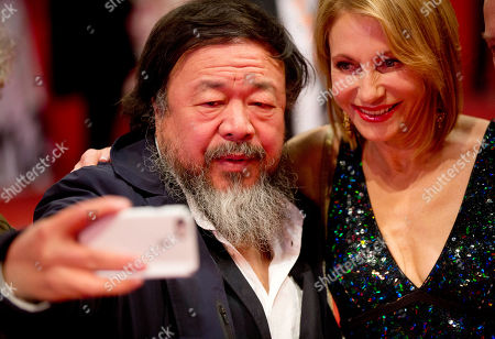 """Chinese artist Ai Weiwei takes a selfie with Kimberly Marteau Emerson, wife of the American Ambassador to Germany, at the red carpet for """"Hail, Caesar!"""" the opening film of the 2016 Berlinale Film Festival in Berlin, Germany"""