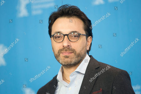 Director Mohamed Ben Attia poses for the photographers during a photo call for the film 'Inhebbek Hedi' at the 2016 Berlinale Film Festival in Berlin, Germany