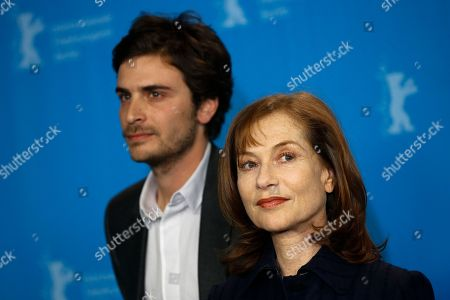 Actors Roman Kolinka, left, and Isabelle Huppert pose for photographer during a photo call for the competition film 'Things To Come' at the 2016 Berlinale Film Festival in Berlin