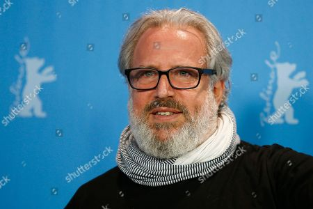 Director and producer Udi Aloni poses for the photographers during a photo call for the film 'Junction 48' at the 2016 Berlinale Film Festival in Berlin, Germany