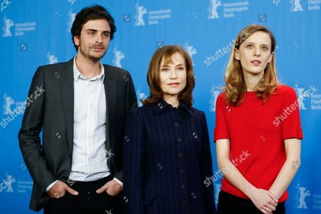 Actors Roman Kolinka, Isabelle Huppert and Director Mia Hansen-Love, from left, pose for photographer during a photo call for the competition film 'Things To Come' at the 2016 Berlinale Film Festival in Berlin