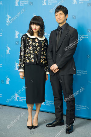 Actress Shioli Kutsuna, left, and actor Hidetoshi Nishijima, right, pose for the photographers during a photo call for the film 'While the Women Are Sleeping' at the 2016 Berlinale Film Festival in Berlin, Germany